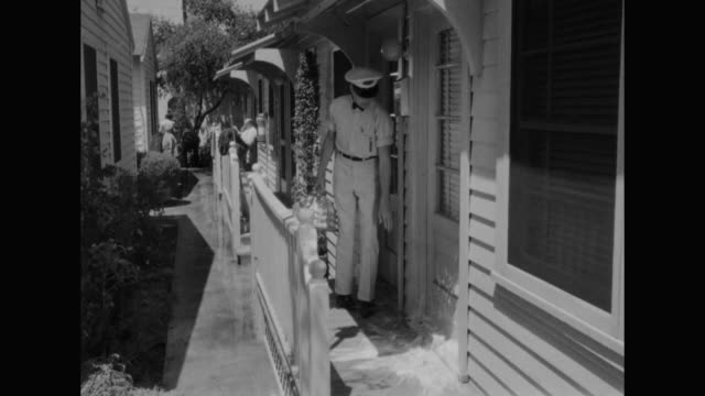 1948 a man becomes suspicious when the milkman breaks a bottle at his door - milkman stock videos & royalty-free footage