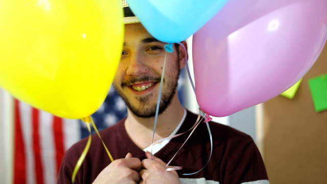 Man behind the balloons