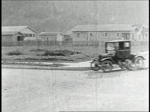 b/w 1925 man being dragged by runaway car on street + being flung off when car turns corner / feat. - 1925 stock videos & royalty-free footage