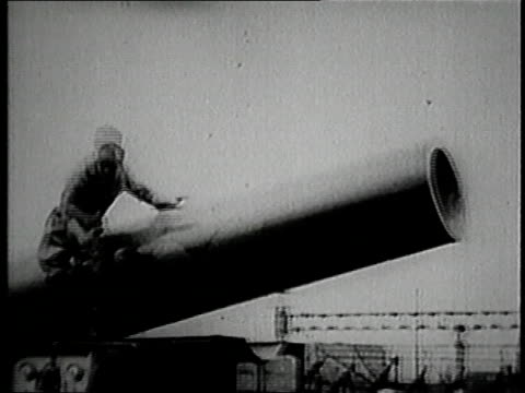 1929 montage man being shot out of a cannon and landing in a net / united states - cannon stock videos & royalty-free footage