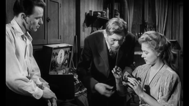 1955 man (frank sinatra) believes handicapped woman's (eleanor parker) doctor is a quack - hausbesuch stock-videos und b-roll-filmmaterial
