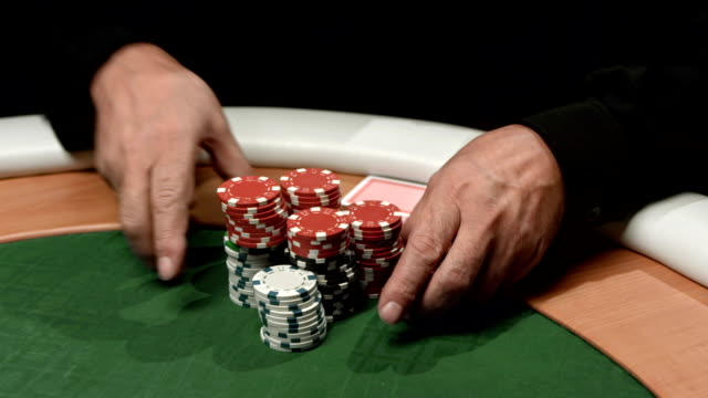 hd: man betting all chips in poker - blackjack stock videos and b-roll footage