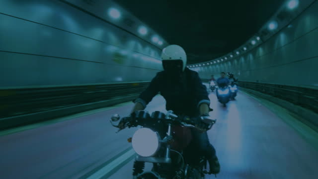 a man biker riding a motorcycle night - motorcycle stock videos & royalty-free footage