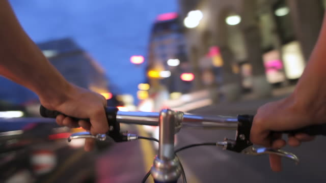ms pov man biking through traffic at night / berlin, germany - motorrad stock-videos und b-roll-filmmaterial