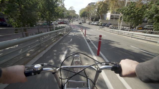 POV man biking with public bike through cycle lane at Barcelona