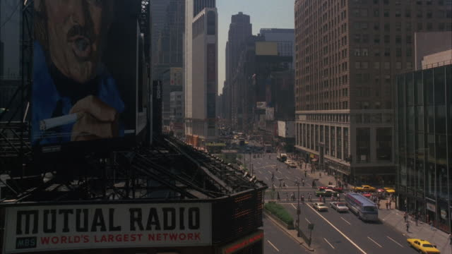 ms man blows smoking poster on mutual radio building at down angle broadway - 1975 stock videos & royalty-free footage