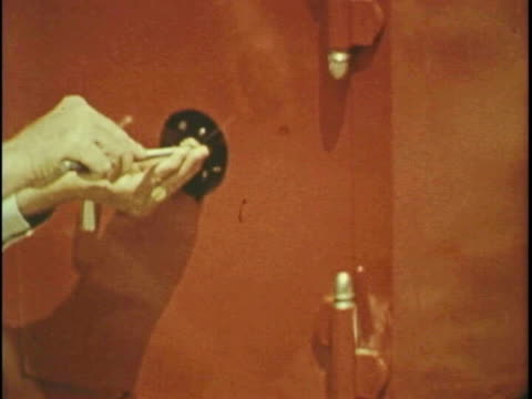 man blows up safe - 予防点の映像素材/bロール