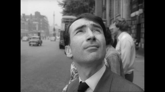 montage a man boards a london bus and chats with the conductor / london, united kingdom - anno 1968 video stock e b–roll