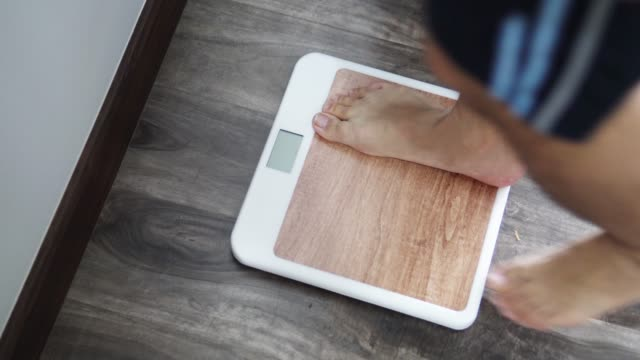 man body weight scale. - mass unit of measurement stock videos and b-roll footage