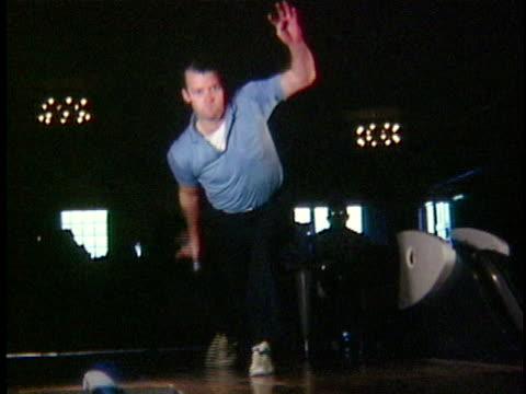 1965 SLO MO MS Man bowling, Vermont, USA