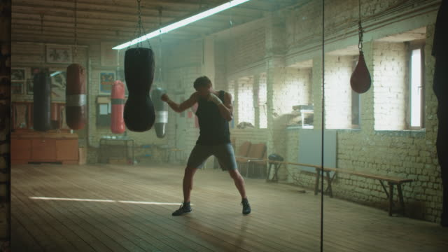 man boxing punshing bag - effort stock videos & royalty-free footage