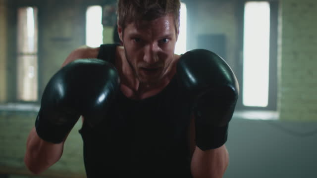 man boxing punshing bag - boxing stock videos & royalty-free footage