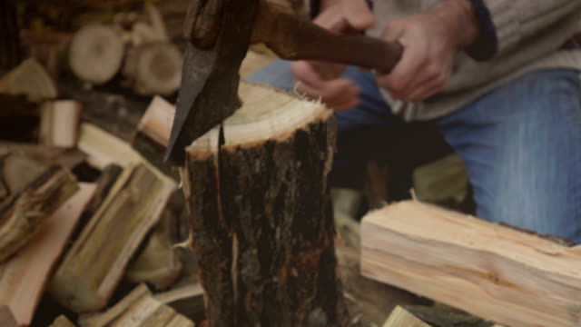 man breaking firewood - firewood stock videos & royalty-free footage