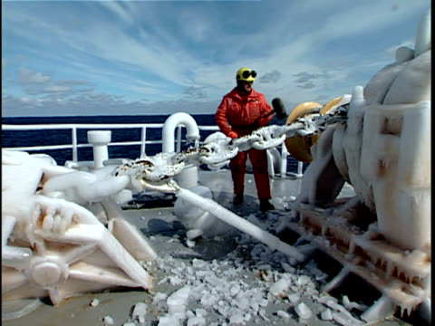 ws man breaking ice buildup on icebreaker bow after travel through open water, labrador sea, canada - chain stock videos & royalty-free footage