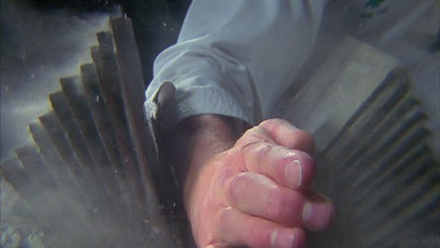 vídeos de stock, filmes e b-roll de slo mo, ecu, man breaking stack of tiles with karate chop, close-up of hand - karate