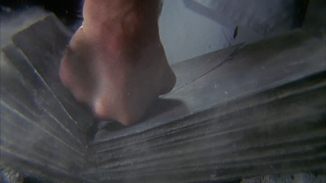 vidéos et rushes de slo mo, ecu, man breaking stack of tiles with karate chop, close-up of hand - impact