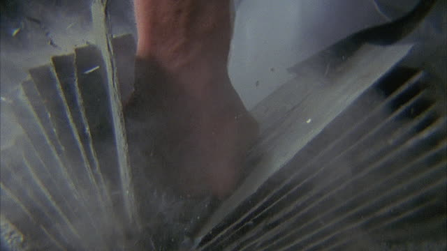 SLO MO, ECU, Man breaking stack of tiles with karate chop, close-up of hand