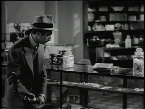 vídeos de stock e filmes b-roll de 1945 man breaks glass cases with an ax - cristaleira