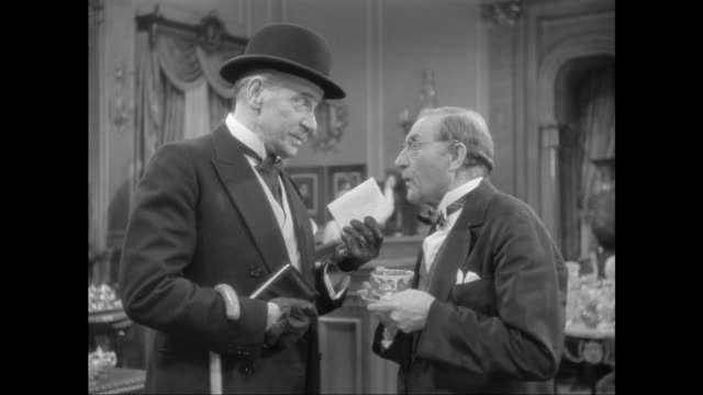1946 man bribes auctioneer to determine location of sold music boxes - corruption stock videos and b-roll footage