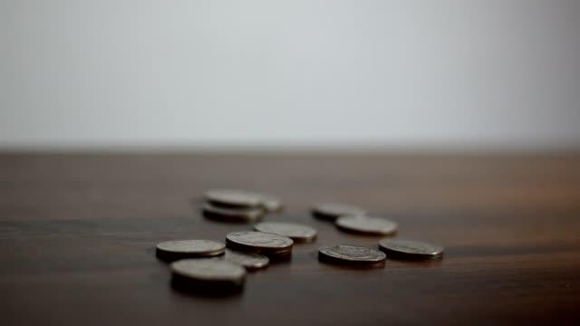 man bring out coins - moneta video stock e b–roll