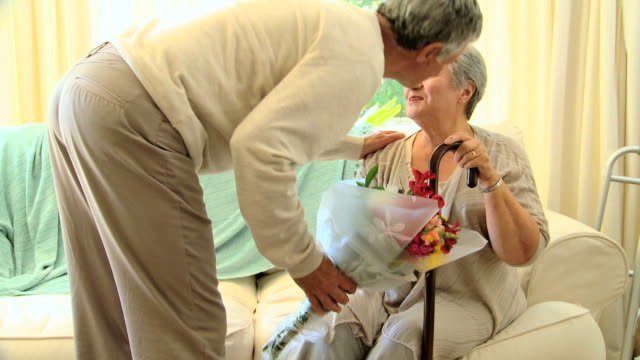 man bringing a bunch of flowers to his wife in hospital / cape town, western cape, south africa - walking cane stock videos and b-roll footage
