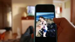 Man browsing photos on his smartphone