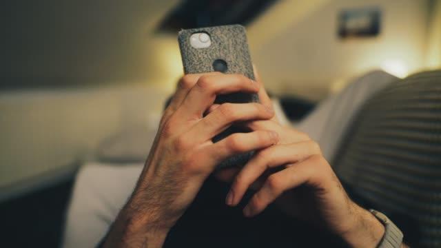 man browsing through his phone - modern manhood stock videos & royalty-free footage