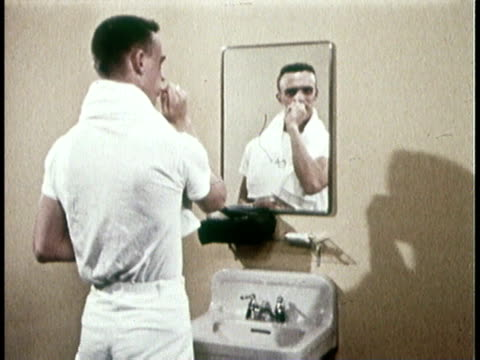 1966 montage man brushing teeth with stanis fluoride dentifrice - brushing teeth stock videos & royalty-free footage