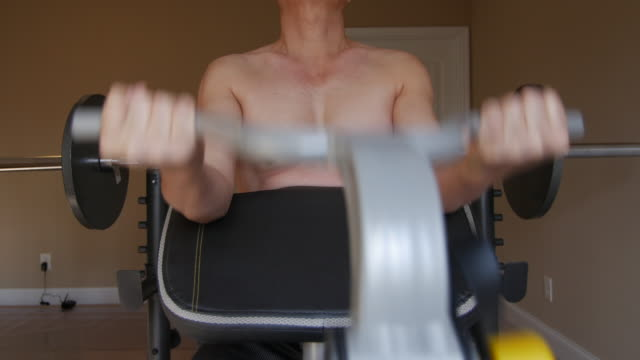 man building up muscle at home - only mature men stock videos and b-roll footage