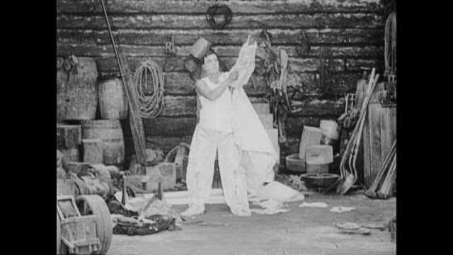1922 man (buster keaton) builds fire retardant suit out of asbestos - asbest stock-videos und b-roll-filmmaterial