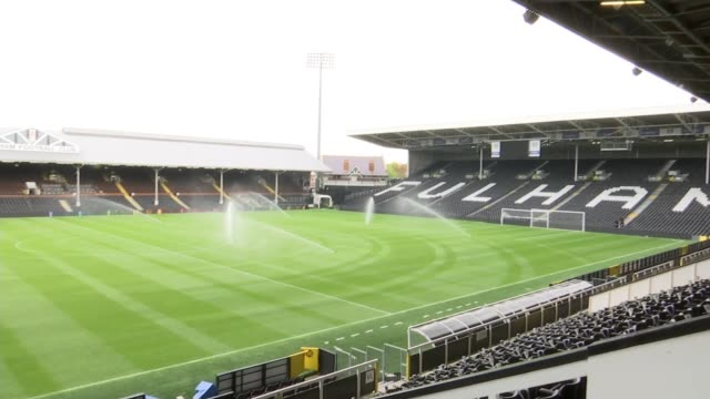 man builds football grounds from lego bricks london craven cottage ext smith wearing fulham football shirt buillding a model of fulham fc's craven... - offbeat stock videos and b-roll footage