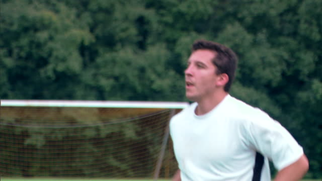 Man bumping soccer ball with chest