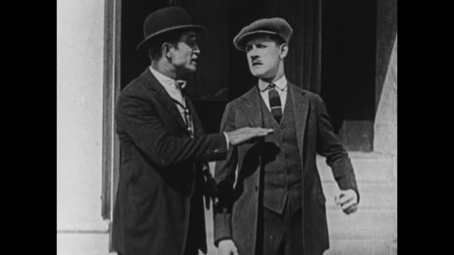1924 man bumps into another man and they start fighting - door to door salesperson stock videos & royalty-free footage