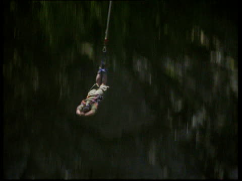 man bungee jumps off kawarau suspension bridge and touches river below queenstown - suspension bridge stock videos & royalty-free footage
