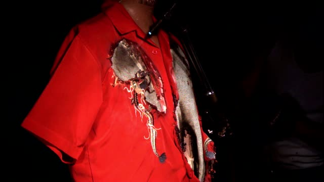 a man burns a red shirt with a blow torch. - burning stock videos & royalty-free footage