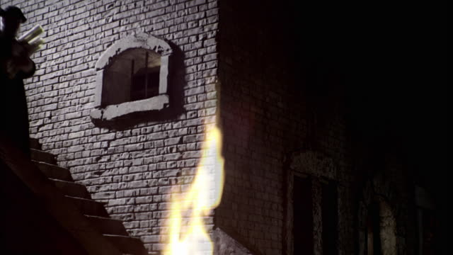 a man burns the writings of nostradamus in a fire. - manuscript stock videos and b-roll footage