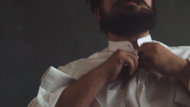 man buttoning shirt closeup. dressed man. dressing up men's. - stereotypically upper class stock videos and b-roll footage