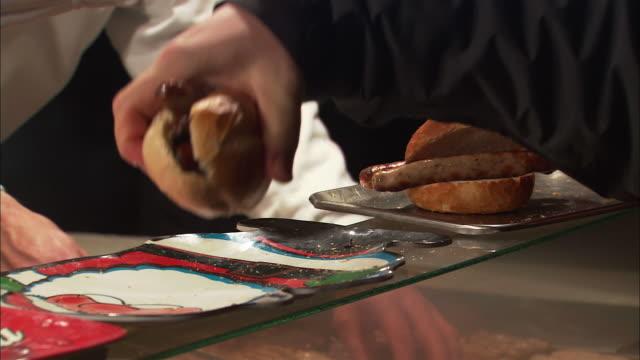 cu man buying bratwurst at christmas market (christkindlesmarkt) / nuremberg, bavaria, germany - nuremberg stock videos & royalty-free footage