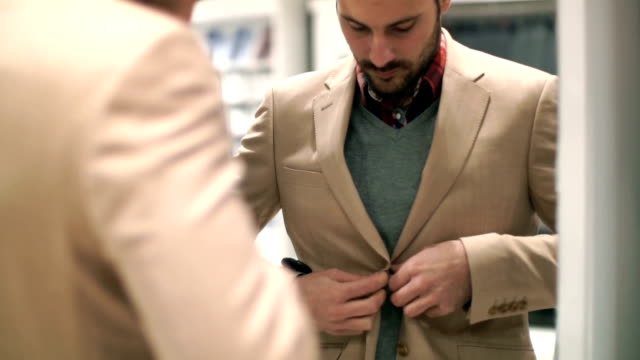man buying clothes at retail store. - male likeness stock videos & royalty-free footage