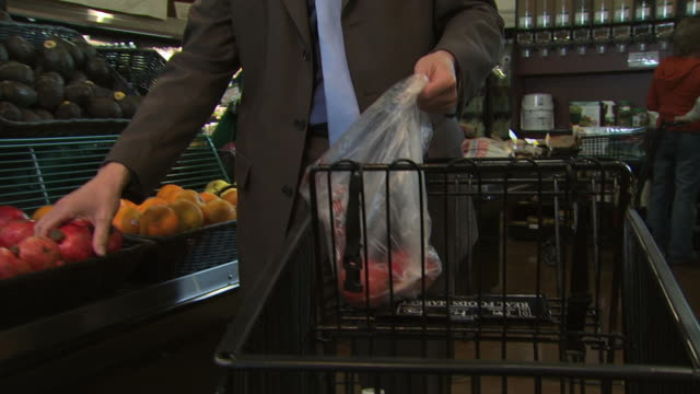 man buying organic fruit - see other clips from this shoot 1172 stock videos & royalty-free footage