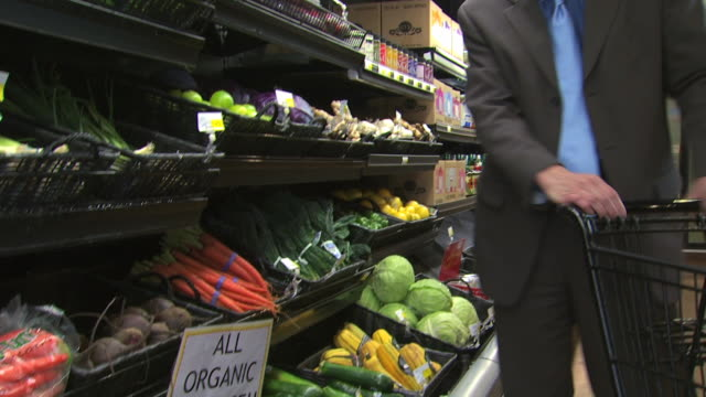 man buying organic produce - see other clips from this shoot 1172 stock videos & royalty-free footage