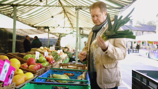 man buying vegetables at outdoor market - video stock videos & royalty-free footage