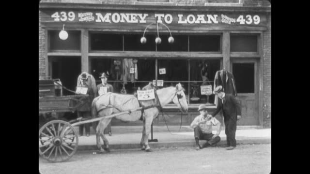 1922 Man (Buster Keaton) buys horse and wagon