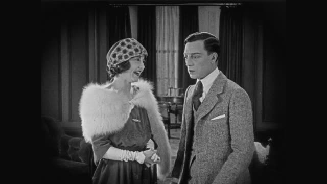 1920 Man (Buster Keaton) buys seat on stock exchange