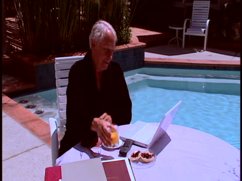 man by pool - silver surfer stock videos & royalty-free footage