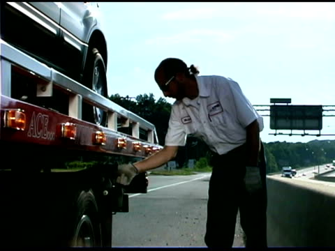 man by truck - tow truck stock videos and b-roll footage