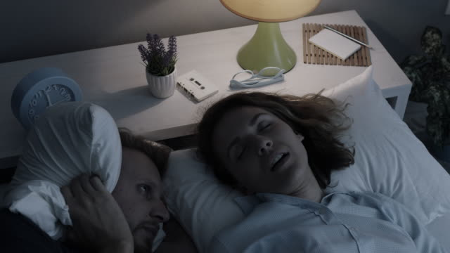 man cannot sleep because his wife snores - snoring stock videos and b-roll footage