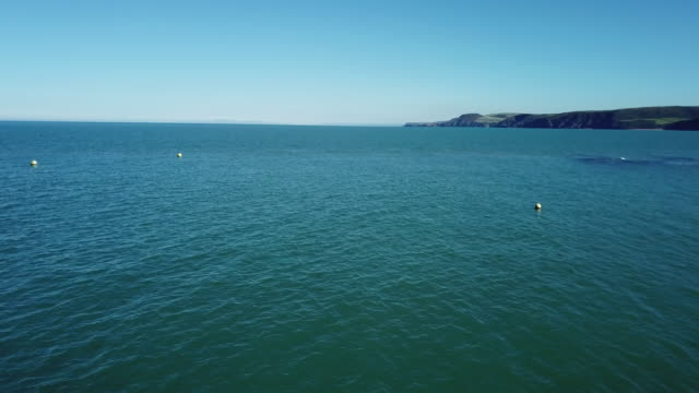 a man canoeing on the sea / wales, uk - small boat stock videos & royalty-free footage