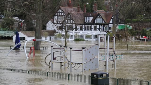 a man canoes through a playground flooded in shrewsbury by the river severn after the wettest february ever recorded in the uk febrary 2020 - small boat stock videos & royalty-free footage