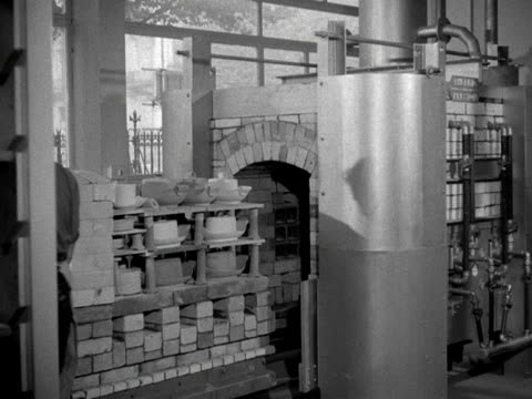 a man carefully place crockery into a kiln at the royal college of arts - kiln stock videos and b-roll footage